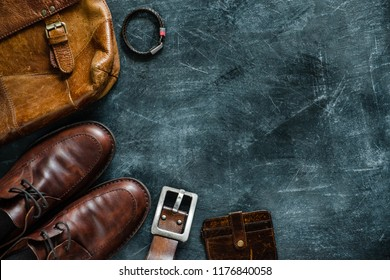 Men's casual outfits with leather accessories on a grey background