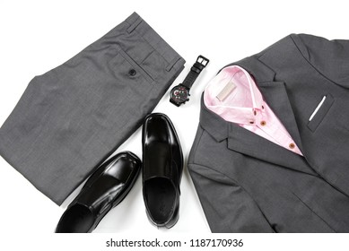 Men's casual outfits for man clothing set with office shoes , watch, trousers, pink shirt and gray suit isolated on white background, Top view