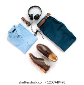 Men's casual outfits for man clothing set with brown shoes , watch, belt, trousers, shirt and earphone isolated on a white background, Top view