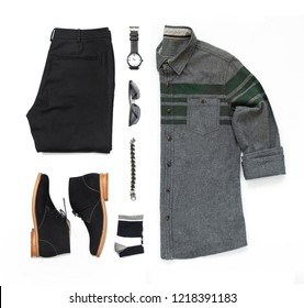 Men's casual outfits for man clothing set with black boot , watch, sock, sunglasses, trousers, office shirt and bracelet isolated on white background, Top view