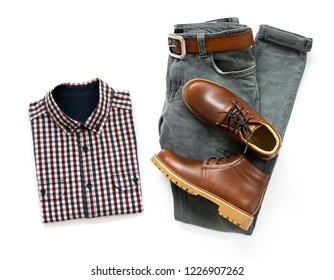 Men's casual outfits for man clothing set with brown boots, belt and gray jeans isolated on a white background. Top view