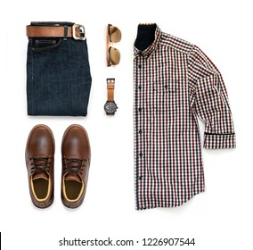 Men's casual outfits for man clothing set with brown ankle boot , watch, blue jeans, belt, sunglasses and office shirt isolated on a white background, Top view