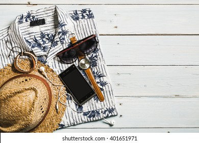 Men's casual outfits on wood board background, Essential vacation item for traveler