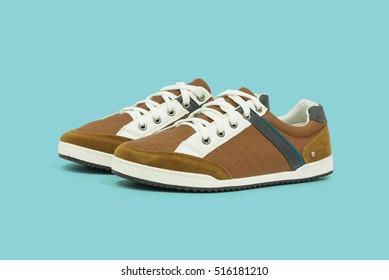 Men's casual shoes on plain background
