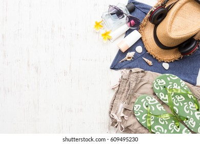 Men's casual summer clothes with accessories items on white rustic wooden board background, overhead top view, flay lay