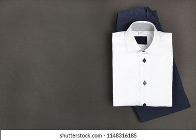 Men's classic shirt and trousers on black background. Concept school uniform.