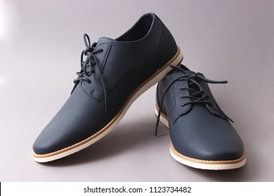 men's classic shoes on a gray background. men's shoes, minimalism