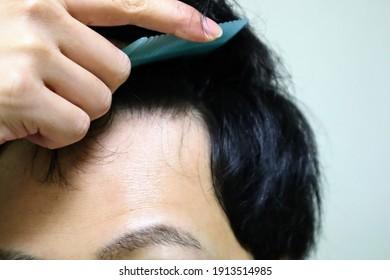 Men's close up to set hair