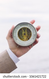 Men's close-up hand holding barometer