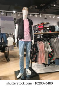 Men's clothing store. Mannequins dressed in ,sweater, jacket, shirts in clothing store