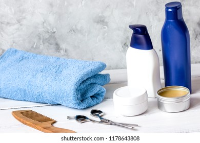 Men's cosmetics for hair care on wooden background