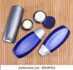Mens cosmetics. Various cosmetic products for men on a wooden surface. Top view