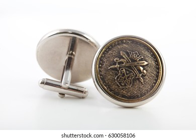 men's cufflinks on a white isolated background