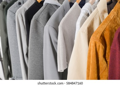 men's different clothes, jacket ,coat on hangers