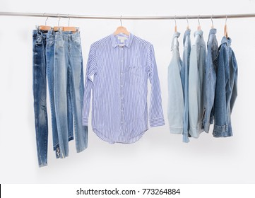 Men's different jeans and jacket with shirt on hanger
