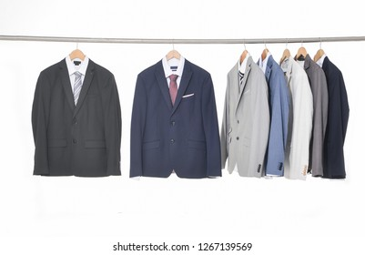 Men's different Set of suits Shirts with ties on hangers
