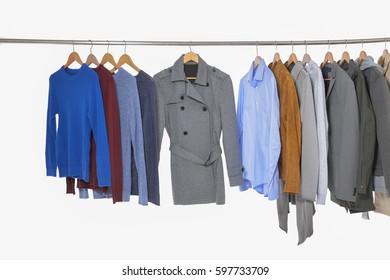 men's different suit clothes ,coat, jacket ,coat,trousers, scarf, on hangers