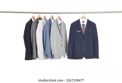 Men's different suits, Shirts with ties on hangers