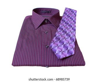 A mens dress shirt and tie on a what background