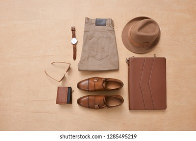 Men's fashion clothing and accessories-wooden background