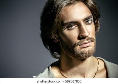 Men's fashion concept. Portrait of a handsome masculine man.