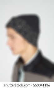 Mens fashion theme creative abstract blur background with bokeh effect. Young man showing new clothes for internet store