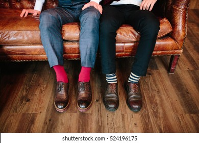 Men's feet in stylish shoes and bright socks