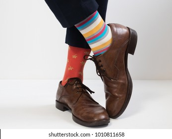 Men's feet in stylish shoes and funny socks