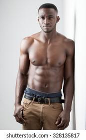 Men's Fitness, dark skinned model on white background