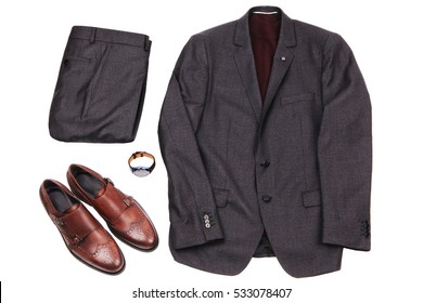 men's gray suit with a red golf , brown leather shoes and wristwatch. Stylish office look. All objects are isolated on white background