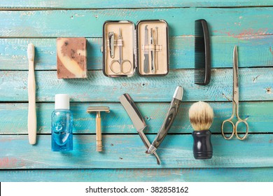 Mens grooming tools on a blue background