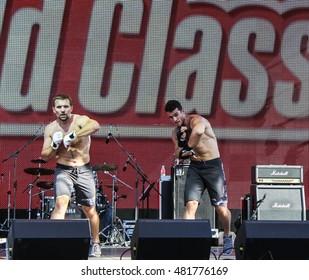 Men's group show. St. Petersburg, Russia - 12 August, 2016. Sport dancing men on Harley Davidson festival in St. Petersburg.