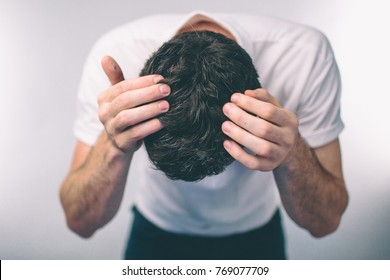 Men's hair is a top view close-up. ?ark-haired man? Gray hair and Dandruff