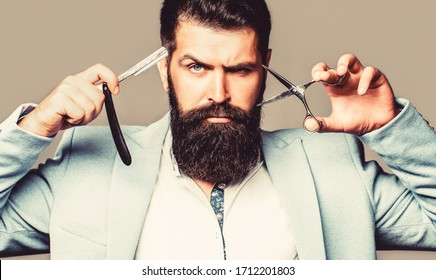 Mens haircut. Barber scissors and straight razor, barber shop Beard man, bearded male. Portrait beard man. Barber scissors and straight razor, barber shop, suit.