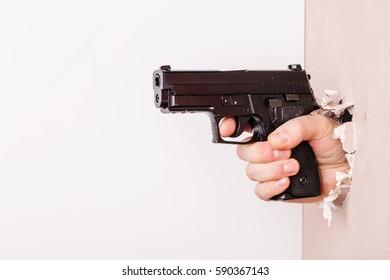 Men's hand with a gun
