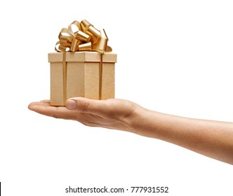 Men's hand holding golden gift box isolated on white background. High resolution product