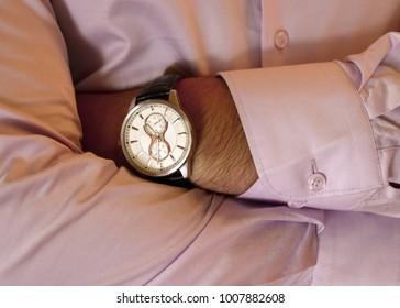 Men's hand with a watch