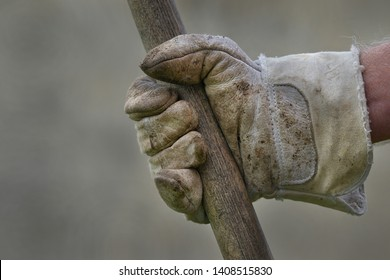 Men's hand with work glove