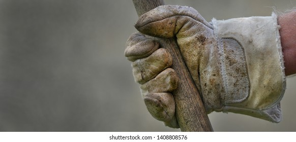 Men's hand with work gloves