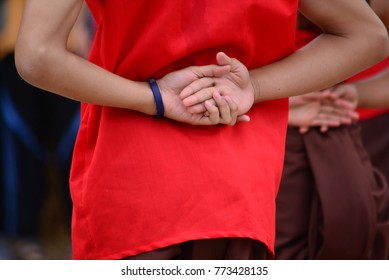 Men's hands crossed at the back