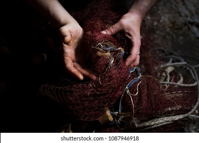 Men's hands and fishing nets close-up