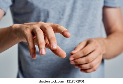 men's hands gray t shirt  bactericidal plaster