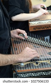 Men's hands playing on gusli