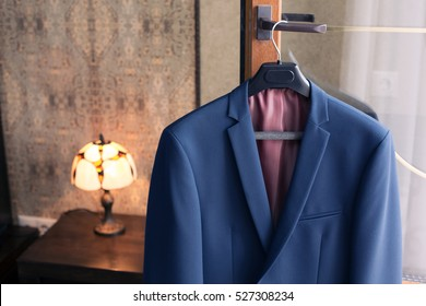 men's jacket on a hanger in the room