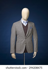 mens jacket on a manequin isolated on a blue background.
