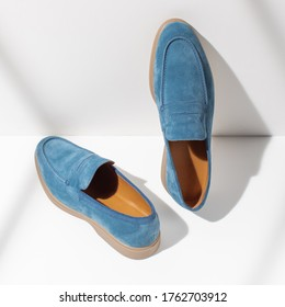 Men's leather blue loafers on a white background. Stylish men's shoes