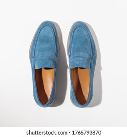 Men's leather blue loafers on a white background, top view. Stylish men's shoes