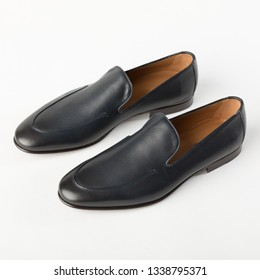 Men's leather loafers on a white background.