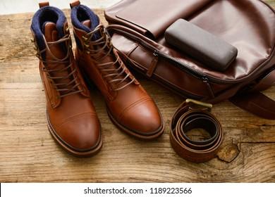 Men's leather shoes, belt, sunglasses, bag ,purse on old wooden background