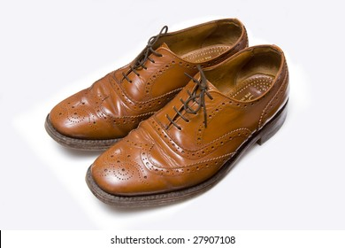 Mens leather shoes isolated on a white studio background